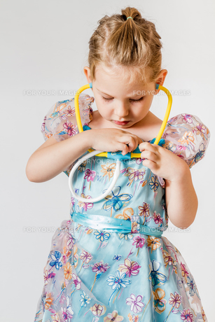 Blonde Little Girl Playing with Colorful Letters FYI00764174