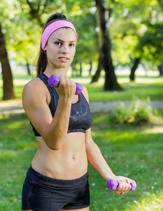 Fitness Slim Woman Training With Dumbbells FYI00775982