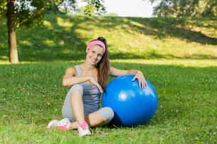 Fitness Healthy Young Woman With Pilates Ball Outdoor FYI00775987