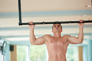 handsome young mand working out in gym FYI00776029