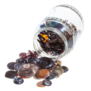 glass pot with clothes buttons isolated FYI00776497