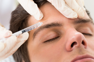 Man Having Botox Treatment FYI00778640