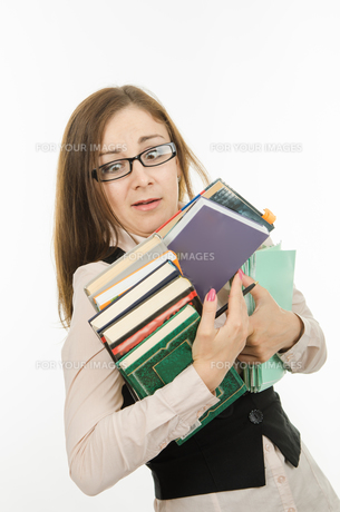 Funny teacher with books and notebooks FYI00793052