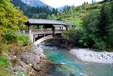 view on a mountain river and an old wooden bridge in bavaria,germany FYI00803749
