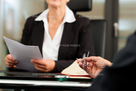 lawyer or notary in her office FYI00825446