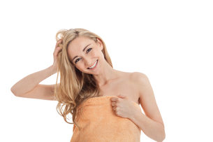 attractive young woman laughing with a towel isolated FYI00879777