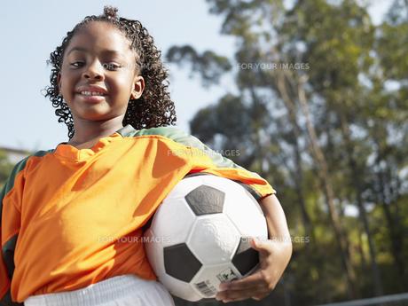 Girl holding soccer ball FYI00900027