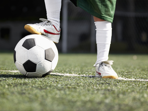 Child s foot on soccer ball (close-up) FYI00900043