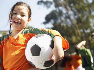 Girl holding soccer ball FYI00900046