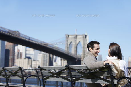 Young couple sitting on bench FYI00900251