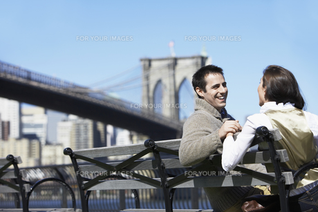 Young couple sitting on bench FYI00900262