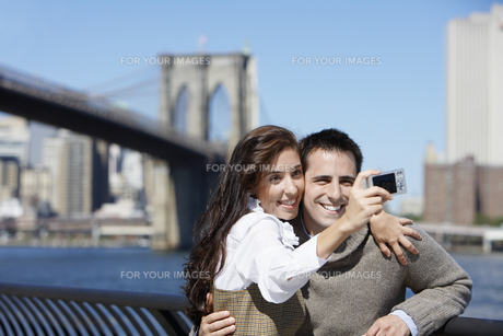 Couple taking photograph of themselves FYI00900268