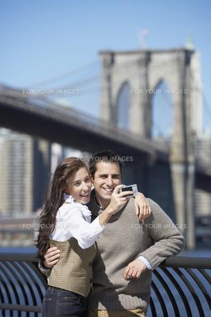 Couple taking photograph FYI00900283