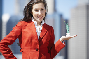 Woman holds miniature Statue of Liberty FYI00900288
