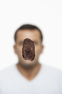 Fingerprint covering mans face FYI00900736