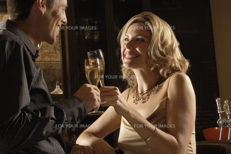Mid adult couple toasting with champagne FYI00902393