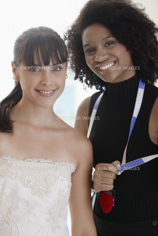 Portrait of bride and tailor FYI00903009