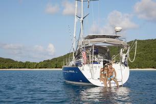 Mid adult couple sitting on sailboat FYI00903400