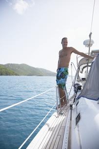 Mid adult man on sailboat FYI00903709