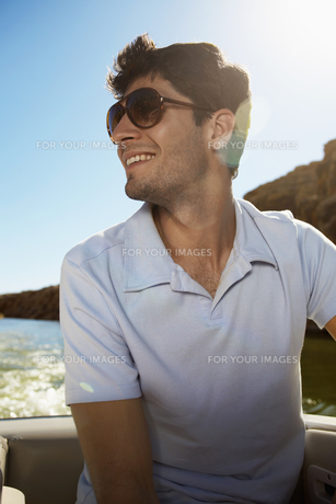 Young man in motorboat FYI00904003