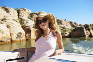 Young woman in motorboat FYI00904035