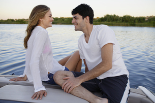 Young couple on motorboat at lake FYI00904080