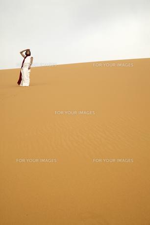 Woman Standing in Desert FYI00905548