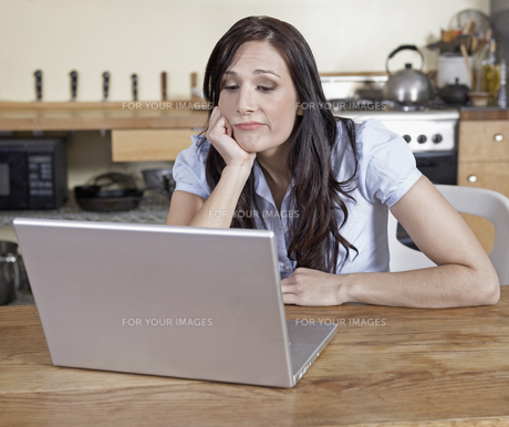 Bored Woman Using Laptop FYI00905599