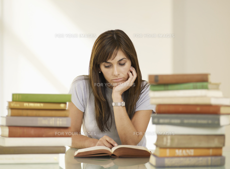 Woman Reading Book FYI00905772