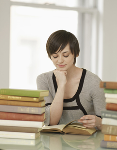 Young Woman Reading Books FYI00905801