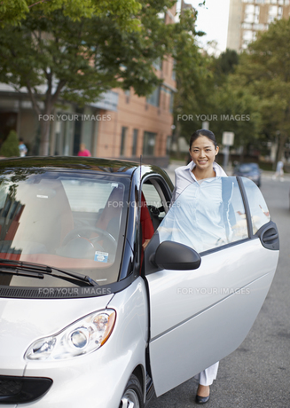 Mid-Adult Woman Getting Into Smart Car FYI00906803