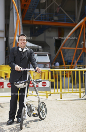 Businessman with Bicycle at Roosevelt Island Tramway FYI00906827