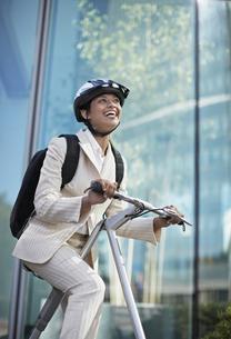 Businesswoman on Folding Bike FYI00906841