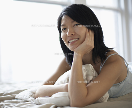Mid-Adult Woman Lying in Bed FYI00907011