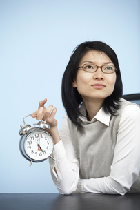 Mid-Adult Businesswoman Holding Alarm Clock FYI00907065