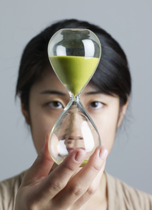 Mid-Adult Woman Holding Hourglass FYI00907224