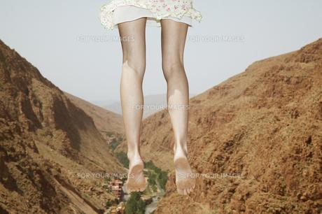 Woman Jumping near Mountains FYI00920419